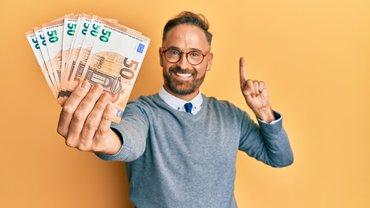 Mann Freude Geld Gelscheine